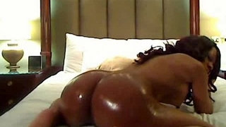 Busty-black-babe-shaking-her-oiled-booty