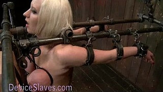 Busty-blonde-bound-in-metal-tormented