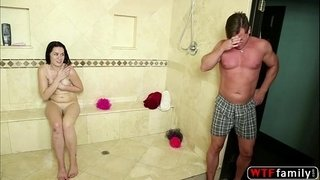 Stunning-babe-gets-fucked-inside-the-shower-room-by-his-BFF-stepdaddy