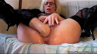 Slutty-grandma-in-stockings-fists-her-hairy-cunt