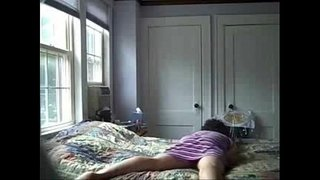 Caught-my-horny-mom-rubbing-pussy-on-bed.-Hidden-cam