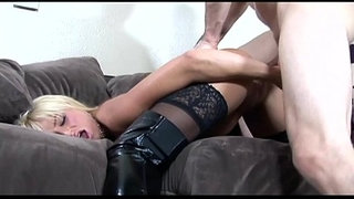 Busty-blonde-fucked-in-black-boots-over-stockings