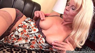 Granny-in-stockings-fucks-herself-with-a-dildo