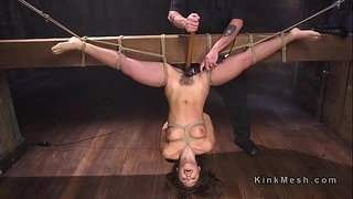 Tied-up-to-wooden-beam-upside-down-brunette-fucked