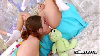 Frisky-lesbians-fill-up-their-enormous-bums-with-milk-and-splatter-it-out