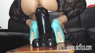 Giant-dildo-stretches-her-greedy-pussy-to-the-max