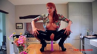 Red-XXX-fucks-herself-with-a-toy-while-in-latex-pants